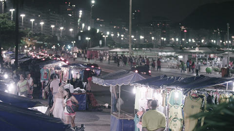 Panning shot of busy vendors in Copacabana Footage