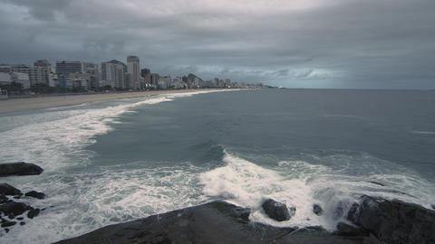 Slow pan of Rio de Janeiro skyline along the beach in Rio de Janeiro, Brazil Live Action