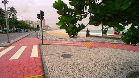 Slow dolly shot of pink sidewalk at Copacabana Beach in Rio de Janeiro, Brazil Footage