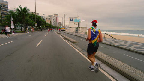 RIO DE JANEIRO, BRAZIL - JUNE 23: Dolly shot of jogger Ipanema Beach June 23, 20 Footage