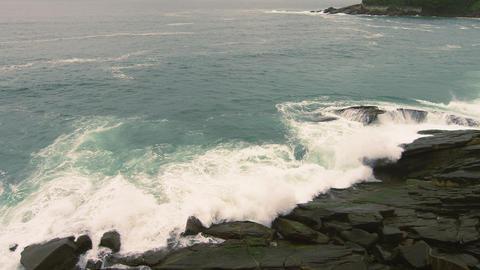 Slow motion shot of rocky seashore in Rio de Janeiro, Brazil Footage