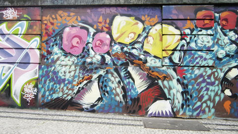 Slow motion dolly shot of graffiti art on perimeter wall of a building in Rio de Footage