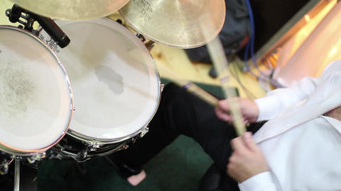 Rhythmic drum beats produced by a drummer during a performance 14 Footage