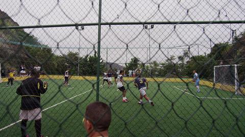 RIO DE JANEIRO, BRAZIL - JUNE 23: Slow motion pan men's soccer game on June 23,  Live Action