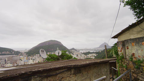 Slow motion tracking shot of favela overlooking the hills in Rio de Janeiro, Bra Footage