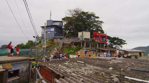 Dolly shot of a favela and its occupants in Rio de Janeiro, Brazil Footage