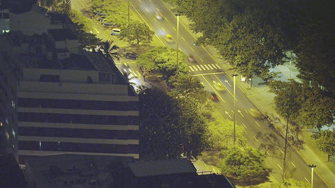 Slow motion pan shot of a lighted street at night in Rio de Janeiro, Brazil Footage