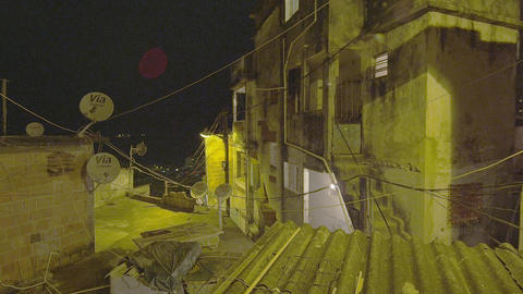 Lens flare pan of houses at a favela in Rio de Janeiro, Brazil Footage