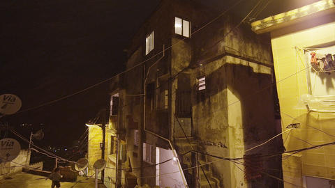 Lens flare panning shot of houses at a favela in Rio de Janeiro, Brazil Footage
