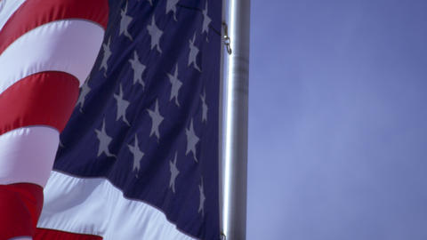 Up close shot of the American flag blowing in the wind Footage