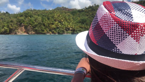 The girl looks from a boat on the peninsula Samana in the Dominican Republic GIF