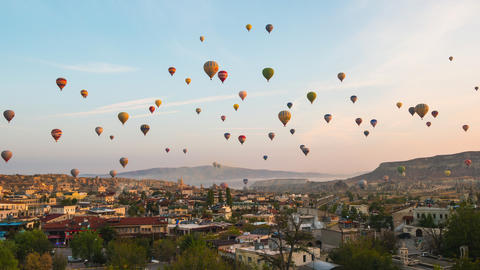 Balloon are flying in Cappadocia with view of Goreme cityscape skyline in Goreme, Turkey time lapse Footage