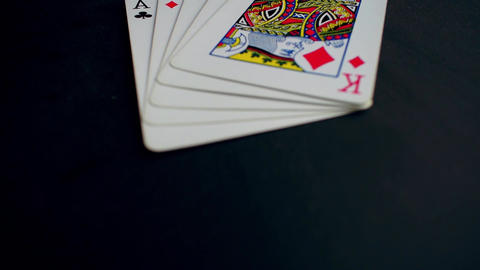 Hand of cards. Four aces and a king. Black table Archivo