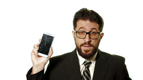 The concept of a broken gadget. Bearded businessman in glasses showing broken Live Action