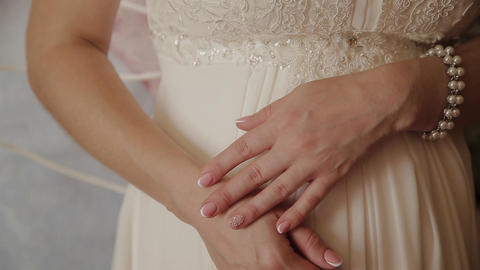 extreme close up of the hands of the bride. Bride in wedding dress close-up of Footage