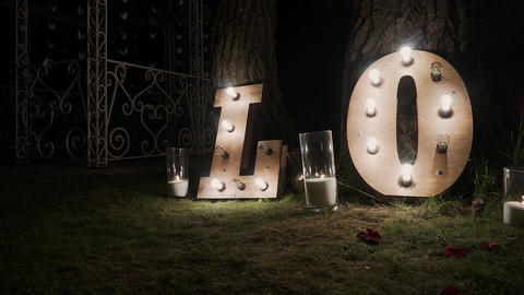 Wooden letters with bulb lights. Word - Love. Illuminated... Stock Video Footage