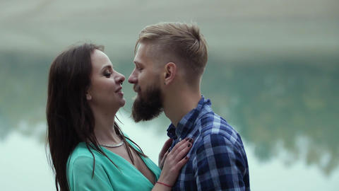 gentle kiss on the background of a turquoise lake Footage