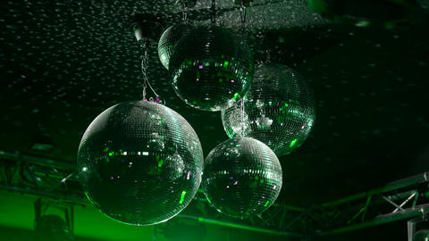 Green Mirrorballs in a club - close up shot Live Action