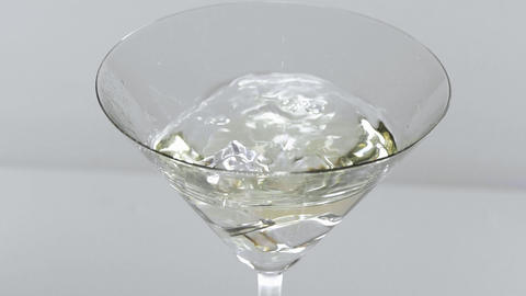 White martini on ice - classic drink Live Action