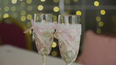 Wedding glasses. Spilling Champagne into glasses. Festive alcohol. The glasses Live Action