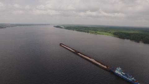 a transport vessel sails along the river Footage