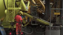 Pouring Cement into Pylon at Construction Site Live Action