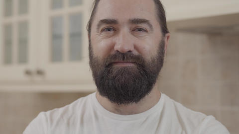 Portrait of smiling bearded man looking in camera close up. Positive beardie Footage
