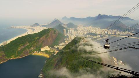 Pan of beautiful Brazilian coastline near Sugarloaf Mountain Footage