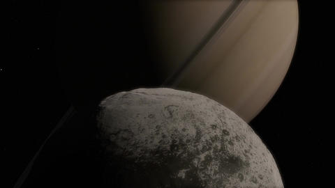 Closeup of Iapetus Moon with a Gigantic Perspective of Saturn Transit Animation