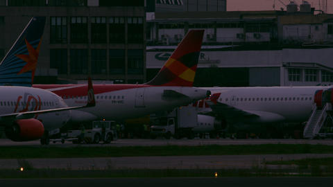 RIO DE JANEIRO, BRAZIL - JUNE 21: Static shot of various airplanes at terminal,  Footage