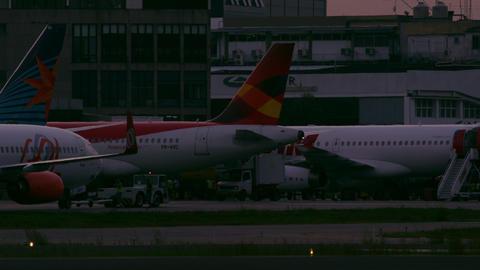 RIO DE JANEIRO, BRAZIL - JUNE 21: Static shot of various airplanes at terminal,  Footage