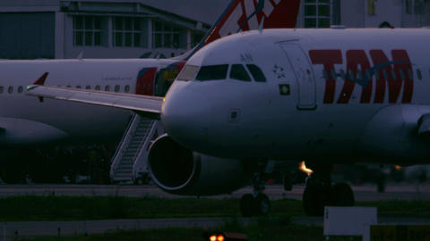 RIO DE JANEIRO, BRAZIL - JUNE 21: Close up of plane taxiing on tarmac of airport Footage