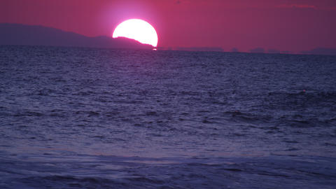 Panoramic shot of the setting sun at the Costa Rican coast Footage