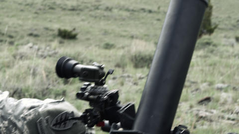 Slow motion shot of soldiers firing mortar and checking target area Footage