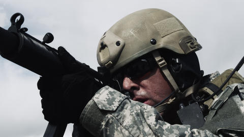 Close up of a soldier firing sub-machine gun, also fixing jammed round Footage