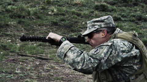 Soldier shooting a sub machine gun Footage