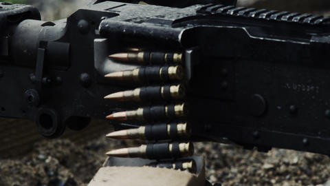 Shot of a belt-fed machine gun as it is fired Footage