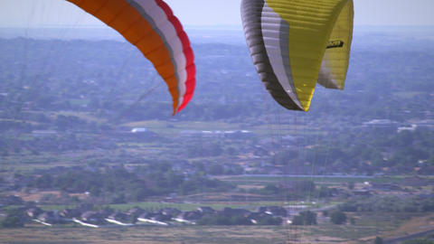 Two people paragliding from one parachute Footage