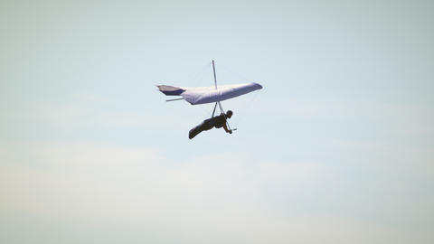 Hang glider in the air turning right then left Footage