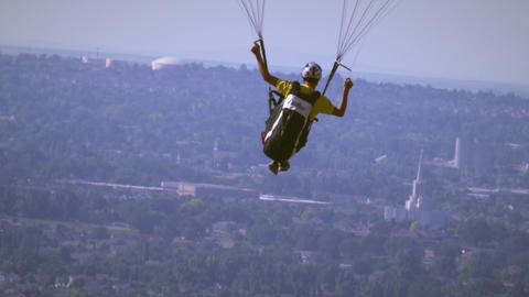 Shot of paragliding man rising above the view of Salt Lake Valley Footage