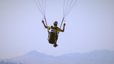 Footage of man paragliding from Point of the mountain near Draper, UT Footage