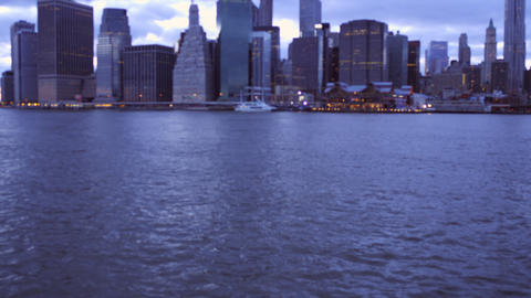 Tilting shot of hudson river and New York Cityscape Live Action