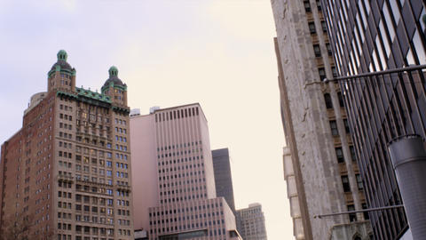 Panning shot of windowed buildings in downtown New York City Footage