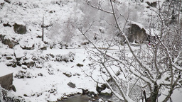 creek with snow-covered banks Footage