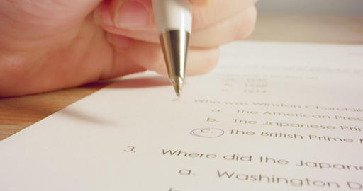 Tracking macro shot of pen marking answers in a history…, Live Action