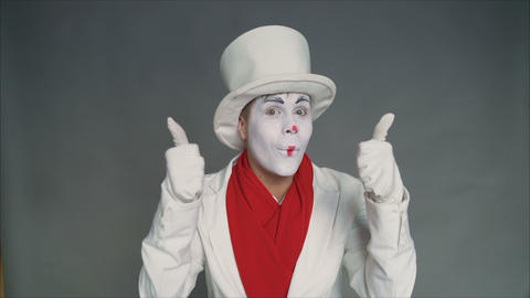 Mime gestures Class. A man's hand shows a gesture of approval. Thumbs up. Hand Live Action