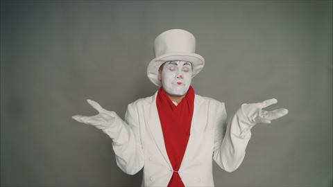 A man is considering a decision. Mime scratching his head, tough decision, on a Footage