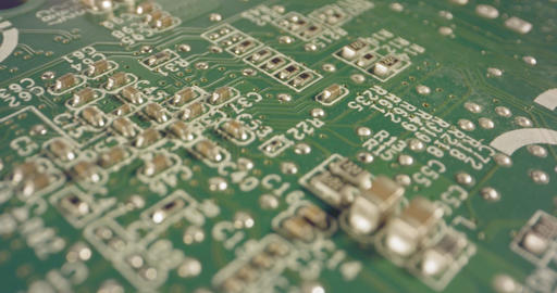 Extreme macro dolly shot of a PCB computer board with capacitors and transistors GIF