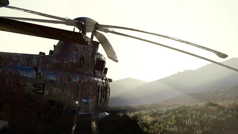 old rusted military helicopter in the desert at sunset Footage