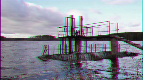 Glitch effect. Water flows over the dam Footage